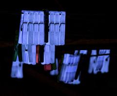 Ghost Pegs (Steve Taylor (Photography)) Tags: pegs washingline digitalart lilac mauve green black contrast dark red plastic newzealand nz southisland canterbury christchurch northnewbrighton