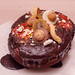 Large chocolate cake with dried fruit
