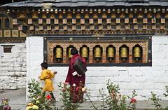 Grandmother and Child (William J H Leonard) Tags: thimphu bhutan bhutanese southasia southasian summer sunny travel travelphotography travelling tashichhodzong buddhist buddhism buddhisttemple architecture asianarchitecture people portrait portraiture portraits building