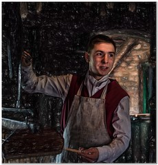 The apprentice (Hugh Stanton) Tags: factory vat candles