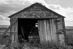 Hidden Treasure (TigerPal) Tags: saskatchewan sask prairie plains abandoned forgotten dustyroad gravelroad ruin ruraldecay rural backroads exploration bechard hiddentreasure car shed garage treasure rusty monochrome pontiac parisienne