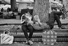 The Man Who Ate Everything (Ian Sane) Tags: ian sane images themanwhoateeverything man woman couple books reading portland farmers market oregon monochrome blackwhite candid street photography canon eos 5ds r camera ef50mm f14 usm lens