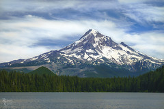 The Mountain and the Lake (RobertCross1 (off and on)) Tags: a7rii alpha cascaderange cascades e55210mmf4563oss emount hoodriver ilce7rm2 lostlake mounthood mounthoodnationalforest mthood or oregon pacificnorthwest sony bluesky boat clouds forest fullframe glacier kayak lake landscape mirrorless mountain nature peak snow trees volcanic volcano water