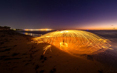 Delayed Spaceship (Eifeltopia) Tags: untertasse ufo sparks beach strand stahlwolle steelwool round hafen westernaustralia roadtrip port stars lightpainting fkk indianocean water lights bluehour blauestunde sundown geraldton erosion journey