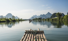 Bamboo raft (Tuzlei) Tags: travel water river mountain nature tree bamboo raft rafting sky cloud blue green reflection color geography karst landform landscape outdoor