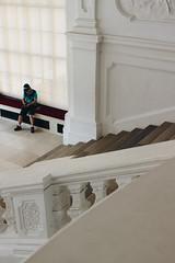 Leave me alone (matteoguidetti) Tags: man sitting building portrait marble white vienna wien solitude solitudine staring belvedere