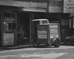 Slow News Day (Beegee49) Tags: newspaper delivery round cart man sitting news bacolod city philippines