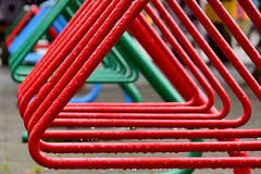 Rinse & Repeat (James_D_Images) Tags: pattern repetition geometry line shape triangle metal bike rack red green blue rain droplets wet granvilleisland vancouver britishcolumbia