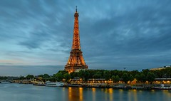The Golden Tower (Aleem Yousaf) Tags: icon cultural attraction tourist capital 2470mm nikkor d810 nikon exposure long sky clouds lights hour blue photography travel structure iron wrought monument historic tower eiffel france paris