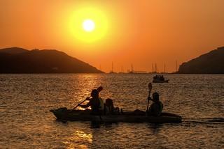 sunset with canoe kayak