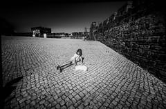 The white cat (Sizun Eye) Tags: bw monochrome girl little cat blackwhite white yard pavement cobblestones walls moorish castle sives portugal sizuneye nikond750 nikon1424mmf28