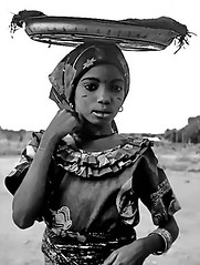 Nigerian Girl (gerard eder) Tags: travel world reise viajes africa nigeria westernafrica girl children child childrenoftheworld people peopleoftheworld portrait blackandwhite blackwhite blancoynegro monochrome bw sw whiteblack outdoor