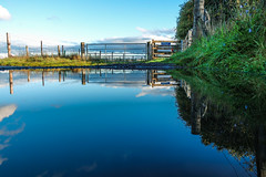 The Gate - Reflection (rattigan_tim) Tags: scotland dornoch bridge firth clouds storm contrast