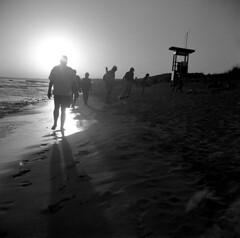 Torre 3 (Gabo Barreto) Tags: sonbou menorca balearicislands baleares beach sand sun people shadows flare light sunset film 120 mediumformat 6x6 tlr twinlensreflex lubitel2 lubitel lomo ilford fp4 rodinal selfdeveloped ishootfilm filmisnotdead analoguephotography scannedfromfilm epsonv500