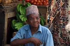 IMGP5412 Street Seller (Claudio e Lucia Images around the world) Tags: stonetown zanzibar market seller man vegetables potato green street salesman road hat grocery fleamarket streetmarket pentax pentaxk30 pentax18135 pentaxart