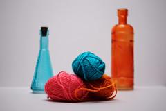 Yarn and Bottles (N.the.Kudzu) Tags: tabletop stilllife bottles yarn canondslr lensbabyburnside35 dxoopticspro11