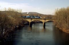 CR GP40-2 3293 GP15 1608 GP40-2 3399 and B23-7 cross the Schuykill River at Birdsboro PA, Feb 10, 1987 (swissuki) Tags: conrail cr gp402 gp15 b237 birdsboro railroads reading pa us