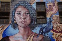 Blue Haired Beauty (soboy5) Tags: streetphotography streetart bushwick bushwickcollective mural brick bricks texture windows building brooklyn nyc ny newyorkcity newyork art graffiti girl blue bird sooc fuji xt1