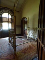 Penrhyn Castle - bedrooms - The Keep Bedrooms - Brass bed in the King's Bedroom