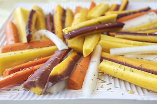 Colorful Sliced Raw Carrots with Rosemary Herb