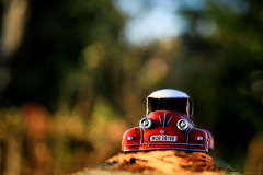 LIfe's too short to drive boring cars (eleni m) Tags: car red toycar outdoor bridge wooden oldie toy speelgoedauto colourfull tin blikken blik