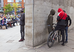 Think someone need a word wit lookout (Mick Steff) Tags: drug dealer dealing manchester urban street trio male wall piccadilly bike people road