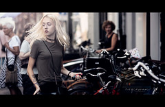 A shooting star, that's what you are (Roy Coumans Photography) Tags: denbosch straatfotografie cinematic streetphotography nikon85mmf18 d750 streetshot blonde girl move bycycle nikon tattoo