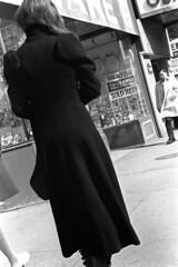 020371 31 (ndpa / s. lundeen, archivist) Tags: nick dewolf nickdewolf blackwhite blackandwhite 35mm film photographbynickdewolf bw february 1971 1970s boston massachusetts city citylife street streetlife candid streetphotography people washingtonstreet woman youngwoman coat man asian pedestrian pedestrians store shop storefront storewindows sign brunette longhair overcoat sidewalk combatzone