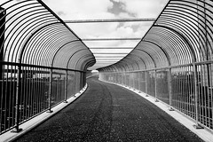 Bridge to Nowhere - Anderston Footbridge (p.mathias) Tags: mono bw glasgow scotland uk europe bridge walk walkway person people sony a5100 august summer blackandwhite geometric monochrome abstract diagonal pattern architecture curve lines symmetry alley photo border surreal city atrium anderston footbridge bnw contrast noiretblanc blackwhite csc united kingdom