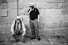 Men with Braces in Panama Hats (Foto John) Tags: picassomuseum leicasl leicasl601 leica leicasltyp601 mirrorless summicronm50mmƒ2iv blackwhite blackandwhite blackandwhitethatsright monochrome streetphotography people men hats panamahats malaga spain candid candidphotography spotted