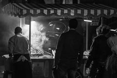 smoke gets in your eyes / parallel bodies (Özgür Gürgey) Tags: 2014 50mm bw d7100 eminönü nikon candid chestnut corn cropped evening lowlight night people smoke street istanbul grainy