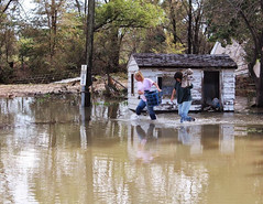 Adams County residents near 96th & McKay Rd carry out belongings after the flooding on September 13, 2013. (Adams County)