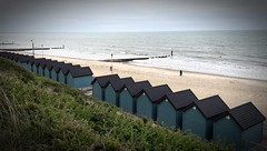 Plastic soulless beach huts with no character.... (markwilkins64) Tags: green solitary deserted lamppost signposts sand waves headland beachcomber overcast autumn seaside solent sea markwilkins uk england dorset christchurch huts beachhuts beach