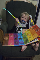 Ash Day 638 (evaxebra) Tags: ash pajamas reading book glow bracelet stick rocking chair pacifier