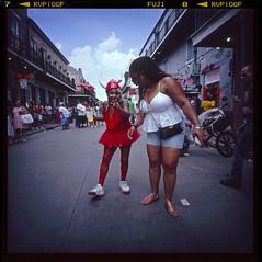 8 ~ Bourbon Street Devil (LANCEPHOTO) Tags: nola fuji fujichrome velvia100 lca120 6x6 squareformat mediumformat lomography expiredfilm chromefilm slidefilm color thedarkroom e6 bourbonstreet streetphotography film4life