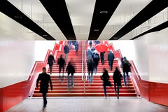 Metro, Amsterdam Central Station, the Netherlands (Mike Bink fotografie) Tags: architecturalphotography mikebink umbrella red stairs architecture centralstation amsterdam subway metro people nikon