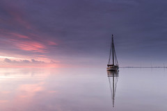 Mary (merseamillsy) Tags: tranquil sunrise calm wooden purple water reflections smack sailingboat sea fishing seascape oystersmack coastal dredger essex boat lilac reflection mast traditional