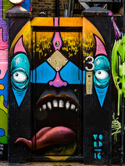I Need Some Mouth Wash (Steve Taylor (Photography)) Tags: void 2016 tongue mouth teeth door 3 buzzer face alien eyes son pest buda graffiti mural streetart tag blue black pink yellow uk england london camden gb greatbritain surreal