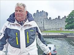Irish Boatman Leaving Ross Castle (Runemaker) Tags: ireland irish boat boatman rosscastle ross castle killarney nationalpark