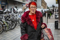 Red (Leanne Boulton) Tags: portrait urban street candid portraiture streetphotography candidstreetphotography candidportrait streetportrait eyecontact candideyecontact streetlife woman female lady face eyes expression mood feeling look emotion bright red hair hairstyle fashion style tone texture detail depthoffield bokeh naturallight outdoor light shade city scene human life living humanity society culture lifestyle people canon canon5dmkiii 70mm ef2470mmf28liiusm color colour glasgow scotland uk