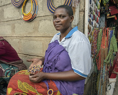 Woman with beadwork (tmeallen) Tags: woman african portrait beadwork maasai market culture necklaces earrings tanzania souvenirs handicrafts eastafrica