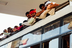 Pilgrims on top of Bus (AdamCohn) Tags: adamcohn india mathura vrindavan holi wwwadamcohncom