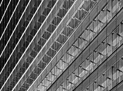 glass facade (heinzkren) Tags: glas building gebäude structur abstract schwarzweis blackandwhite bw sw monochrome lines linien geometry wien vienna austria panasonic lumix tower ares arestower kagran donaucity skyscraper symmetry glass facade colorgradient farbverlauf contemporary architecture architektur diagonale windows fenster pattern hochhaus modern fassade