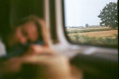 Train (Tamar Burduli) Tags: analog film color 35mm nature landscape window train people female girl sleeping focus poland travel tamarburduli zenit kodak