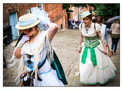 Steep Hill (Photography And All That) Tags: steephill lincoln steep hill climb climbing walking rain raining woman women victorian steampunk steampunks dress hats costume costumes dresses hat road street streetphotography streets streetphotograph sony sonyalpha7mark3 sonyilce7m3 sonyalpha ilce7m3 colour colours festival festivals event events daytime expression expressions expressive portraits whitephotoborder lincs asylum steampunkweekend august 2018 gaze eye contact