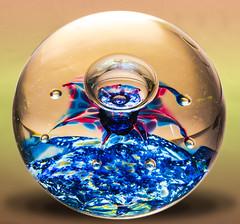 Macro Mondays - Glass (PhilDL) Tags: macromondays glass glasspaperweight closeup macro colours multicolour bubbles red blue ornament skill craft photography nikon nikonuk