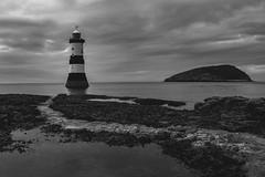 Rocky Lighthouse (Oscar Chidlow) Tags: lighthouse wales cymru britain landscape clouds sea seascape beach rocks rocky bnw black white