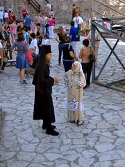 Ortodox Preacher and Woman are Talking before the Show (Superoperater hero) Tags: 2012 berbagrozdja daniberbe predstava putovanja smederevo smederevskajesen smederevskatvrdjava srbija tvrdjava vasar