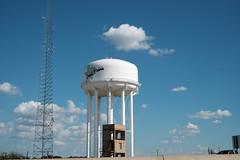 View From Traffic Jam (Gene Ellison) Tags: watertower grandprarie firepractice building tower sky blue clouds