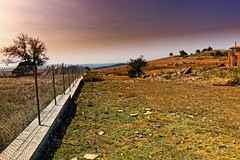 The Fence And A Crumbled Building (Alfred Grupstra) Tags: nature ruralscene fence outdoors sky landscape hill road nopeople scenics grass farm summer agriculture europe footpath autumn tree sunset blue bulgaria 862